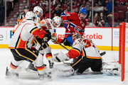 Goaltender Niklas Backstrom #32 of the Calgary Flames makes a pad save near Tomas Plekanec #14 of the Montreal Canadiens during the NHL game at the Bell Centre on March 20, 2016 in Montreal, Quebec, Canada.