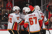The Calgary Flames celebrate a goal at 13:52 of the second period against the New Jersey Devils by Mark Giordano #5  (2nd from left) at the Prudential Center on February 27, 2019 in Newark, New Jersey.