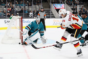 Martin Jones #31 of the San Jose Sharks makes a save on a shot taken by Mikael Backlund #11 of the Calgary Flames during their preseason game at SAP Center on September 27, 2018 in San Jose, California.