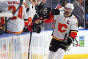Mark Giordano #5 of the Calgary Flames celebrates his goal with his teammates during the second period against the Buffalo Sabres at KeyBank Center on March 7, 2018 in Buffalo, New York.
