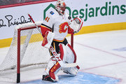 Goaltender Mike Smith #41 of the Calgary Flames tosses the puck in the warm-up prior to the NHL game against the Montreal Canadiens at the Bell Centre on October 23, 2018 in Montreal, Quebec, Canada.  The Montreal Canadiens defeated the Calgary Flames 3-2.