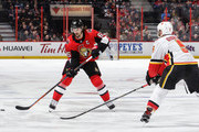 Erik Karlsson #65 of the Ottawa Senators skates with the puck against Mark Giordano #5 of the Calgary Flames at Canadian Tire Centre on March 9, 2018 in Ottawa, Ontario, Canada.  (Photo by Jana Chytilova/Freestyle Photography/Getty Images) *** Local Caption ***