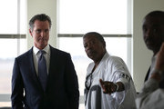 California Lt. Gov. and California gubernatorial candidate Gavin Newsom (L) talks with residents as he visits the Alice Griffith Apartments on August 22, 2018 in San Francisco, California. Lt. Gov. Gavin Newsom and San Francisco mayor London Breed toured a low-income housing complex. Newsom leads Republican gubernatorial candidate John Cox by an average of 23 percentage points in recent polls.