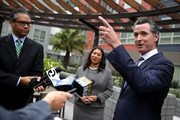 California Lt. Gov. and California gubernatorial candidate Gavin Newsom (R) and San Francisco mayor London Breed (C) talk with members of the media as he visits the Alice Griffith Apartments on August 22, 2018 in San Francisco, California. Lt. Gov. Gavin Newsom and San Francisco mayor London Breed toured a low-income housing complex. Newsom leads Republican gubernatorial candidate John Cox by an average of 23 percentage points in recent polls.