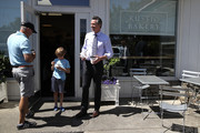Democratic California gubernatorial candidate Lt. Gov. Gavin Newsom (R) stands with his son Hunter Newsom (C) after getting food at Rustic Bakery on June 5, 2018 in Larkspur, California.  California Lt. Gov. Gavin Newson cast his ballot as California voters are heading to the polls to vote in the primary election. Newsom is expected to claim the top spot in the California gubernatorial primary election ahead of republican candidate John Cox and former Los Angeles mayor Antonio Villaraigosa, a democrat.