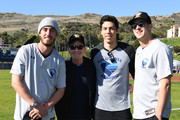 Cody Bellinger, Charlie Sheen, Christian Yelich and Jared Goff attend California Strong Celebrity Softball Game at Pepperdine University Baseball Field on January 12, 2020 in Malibu, California.