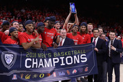 The Arizona Wildcats pose together after defeating the California Golden Bears 66-54 to win the PAC-12 Championship at McKale Center on March 3, 2018 in Tucson, Arizona.