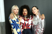 (L-R) Soo-Joo Park, Indya Moore and Irene Kim attend the Calvin Klein Collection fashion show at New York Stock Exchange on September 11, 2018 in New York City.