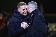 Garry Monk manager of Leeds United and Shaun Derry manager of Cambridge Unitedshake hands prior to the Emirates FA Cup Third Round match between Cambridge United and Leeds United at Cambs Glass Stadium on January 9, 2017 in Cambridge, England.