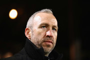 Shaun Derry manager of Cambridge United looks on prior to the Emirates FA Cup Third Round match between Cambridge United and Leeds United at Cambs Glass Stadium on January 9, 2017 in Cambridge, England.