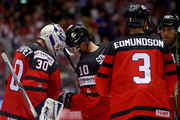 Curtis McElhinney, goaltender of Canada celebrate with team mate Brayden Schenn after the 2018 IIHF Ice Hockey World Championship group stage game between Canada and Denmark at Jyske Bank Boxen on May 7, 2018 in Herning, Denmark.
