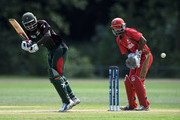 Maurice Ouma of Kenya in action as Ashish Bagai of Canada watches during the ICC World Cricket League Division One match between Canada and Kenya at the Excelsior Cricket Club on July 9, 2010 in Schiedam, Netherlands.
