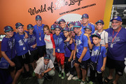 Actress Candace Cameron Bure (C) poses with the Emilia Little League team at the Little League World Series on August 21, 2016 in South Williamsport, Pennsylvania.