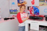 Actress Candace Cameron Bure tests the Canon PIXMA MG7720 in the Canon booth at the Little League World Series on August 21, 2016 in South Williamsport, Pennsylvania.
