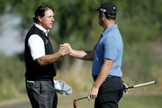 Phil Mickelson and John Rahm of Spain shake hands on the 18th green during practice for the CareerBuilder Challenge at the Jack Nicklaus Tournament Course at PGA West on January 17, 2018 in La Quinta, California.