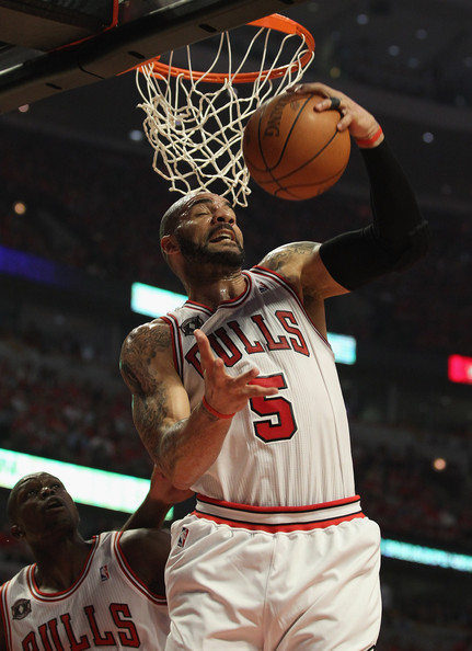 Carlos Boozer Carlos Boozer #5 of the Chicago Bulls grabs a rebound against the Atlanta Hawks in Game Five of the Eastern Conference Semifinals in the 2011 NBA Playoffs at the United Center on May 10, 2011 in Chicago, Illinois. NOTE TO USER: User expressly acknowledges and agrees that, by downloading and/or using this photograph, User is consenting to the terms and conditions of the Getty Images License Agreement.