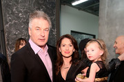 Alec Baldwin, Hilaria Thomas Baldwin and daughter Carmen Baldwin pose for a photo backstage at Carmen Marc Valvo during New York Fashion Week on February 14, 2017 in New York City.