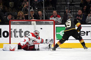 Reilly Smith #19 of the Vegas Golden Knights gets a goal against Cam Ward #30 of the Carolina Hurricanes during a shootout in their game at T-Mobile Arena on December 12, 2017 in Las Vegas, Nevada. The Hurricanes won 3-2 in a shootout.