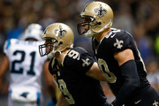 Drew Brees #9 and  Jimmy Graham #80 of the New Orleans Saints celebrate after a touchdown against the Carolina Panthersat Mercedes-Benz Superdome on December 8, 2013 in New Orleans, Louisiana.
