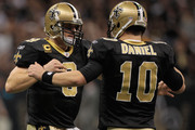 Drew Brees #9 celebrates after a touchdown with  Chase Daniel #10 of the New Orleans Saints during the game against the Carolina Panthers at the Mercedes-Benz Superdome on January 1, 2012 in New Orleans, Louisiana.