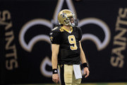 Drew Brees #9 of the New Orleans Saints stands on the field during the game against the Carolina Panthers at the Mercedes-Benz Superdome on January 1, 2012 in New Orleans, Louisiana.