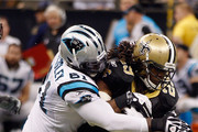 Chris Ivory #29 of the New Orleans Saints is tackled by DeMario Presley #61 of the Carolina Panthers at the Mercedes-Benz Superdome on January 1, 2012 in New Orleans, Louisiana.