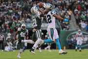 Wide receiver Kaelin Clay #12 of the Carolina Panthers attempts to make a catch over cornerback Morris Claiborne #21 of the New York Jets during the third quarter of the game at MetLife Stadium on November 26, 2017 in East Rutherford, New Jersey.