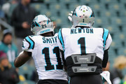 Wide receiver Torrey Smith #11 and quarterback Cam Newton #1 of the Carolina Panthers show camaraderie before taking on the Philadelphia Eagles at Lincoln Financial Field on October 21, 2018 in Philadelphia, Pennsylvania.