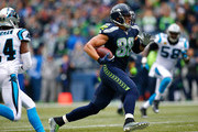 Jimmy Graham #88 of the Seattle Seahawks runs with the ball after making a catch against the Carolina Panthers at CenturyLink Field on October 18, 2015 in Seattle, Washington.