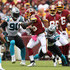 Mike Adams Photos - Running back Adrian Peterson #26 of the Washington Redskins runs with the ball in the first quarter against Mike Adams #29 and Julius Peppers #9 of the Carolina Panthers at FedExField on October 14, 2018 in Landover, Maryland. - Carolina Panthers vs. Washington Redskins