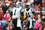 Wide receiver Torrey Smith #11 and quarterback Cam Newton #1 of the Carolina Panthers celebrate after a touchdown in the fourth quarter against the Washington Redskins at FedExField on October 14, 2018 in Landover, Maryland.