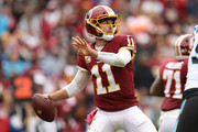 Quarterback Alex Smith #11 of the Washington Redskins throws the ball in the third quarter against the Carolina Panthers at FedExField on October 14, 2018 in Landover, Maryland.