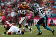 Running back Adrian Peterson #26 of the Washington Redskins runs with the ball against free safety Mike Adams #29 of the Carolina Panther in the fourth quarter at FedExField on October 14, 2018 in Landover, Maryland.