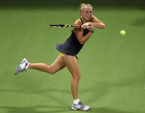 Caroline Wozniacki Caroline Wozniacki of Denmark in action during her match against Samantha Stosur of Australia during day two of the WTA Championships at the Khalifa Tennis Complex on October 27, 2010 in Doha, Qatar.