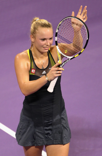 Caroline Wozniacki Caroline Wozniacki of Denmark waves to the crowd after beating Elena Dementieva of Russia during day one of the WTA Championships at the Khalifa Tennis Complex on October 26, 2010 in Doha, Qatar.