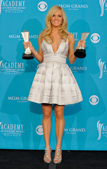 45th Annual Academy Of Country Music Awards - Press Room [blue,flooring,fashion model,cocktail dress,dress,shoulder,carpet,electric blue,leg,joint,carrie underwood,entertainer of the year award,triple crown award,room,press room,mgm grand garden arena,las vegas,nevada,academy of country music awards]