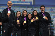 Alessio Sartori (1th R), Romano Battisti (1th L) silver medal in Rowing, Valentina Vezzali (2nd L) ,Arianna Arrigo (3rd L), Ilaria Salvatori (3rd R) , Elisa Di Francisca (2nd R)  gold medal in women's foil fencing team pose with the medal in Casa Italia at London 2012 Olympic Games at The Queen Elizabeth II Conference Centre on July 29, 2012 in London, England.