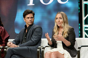 Actor John Stamos (L) and author Caroline Kepnes of Lifetime's 'YOU' speak onstage during The 2018 Summer Television Critics Association Press Tour on July 26, 2018 in Los Angeles, California.