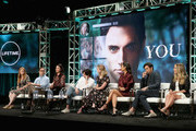 (L-R) Executive Producer Sarah Schechter, Co-Creators and Executive Producers Greg Berlanti and Sera Gamble, actors Penn Badgley, Elizabeth Lail, Shay Mitchell and John Stamos and author Caroline Kepnes of Lifetime's 'YOU' speak onstage during The 2018 Summer Television Critics Association Press Tour on July 26, 2018 in Los Angeles, California.