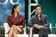 Actors Shay Mitchell (L) and John Stamos of Lifetime's 'YOU' speak onstage during The 2018 Summer Television Critics Association Press Tour on July 26, 2018 in Los Angeles, California.
