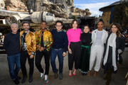ANAHEIM, CA  DECEMBER 02:  In this handout photo provided by Disney Resort, the cast of the upcoming film, Star Wars: The Rise of Skywalker (L-R) Anthony Daniels, Oscar Isaac, John Boyega, director J.J. Abrams, Daisy Ridley, Kelly Marie Tran, Naomi Ackie and Keri Russell pose in front of the Millennium Falcon in Star Wars: Galaxys Edge at Disneyland Park in December 2, 2019 in Anaheim, California, while promoting  Star Wars: The Rise of Skywalker, in theaters December 20.
