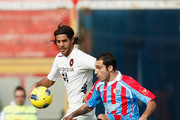 Francesco Lodi (R) of Catania competes for the ball with Joaquin Larrivey of Cagliari during the Serie A match between Catania Calcio and Cagliari Calcio at Stadio Angelo Massimino on December 4, 2011 in Catania, Italy.