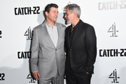 "Kyle Chandler and George Clooney attend the ""Catch 22"" UK premiere on May 15, 2019 in London, United Kingdom."