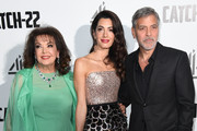 "Baria Alamuddin, Amal Clooney and George Clooney attend the ""Catch 22"" UK premiere on May 15, 2019 in London, United Kingdom."