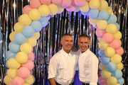 Fashion designers, founders and owners of Dsquared2 Dan Caten and Dean Caten pose for a photo at the Caten Hight School Prom DSquared2 as a part of Pitti Bimbo Kids Fashion Week at Palamattioli on June 21, 2018 in Florence, Italy.