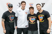 """Mike Moustakas, Christian Yelich, Mike Attanasio and Ryan Braun attend a charity softball game to benefit """"California Strong"""" at Pepperdine University on January 13, 2019 in Malibu, California."""