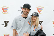 """Chris Backus and Mira Sorvino attend a charity softball game to benefit """"California Strong"""" at Pepperdine University on January 13, 2019 in Malibu, California."""