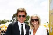 Richard Wilkins and Virginia Burmeister pose on Derby Day at Flemington Racecourse on November 3, 2018 in Melbourne, Australia.