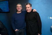 Andy Cohen (L) and fashion designer Isaac Mizrahi pose for a photo during a visit to 'Radio Andy' at SiriusXM Studios on March 11, 2019 in New York City.