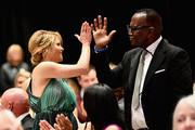 Candace Cameron-Bure (L) and Randy Jackson attend Celebrity Fight Night XXIV on March 10, 2018 in Phoenix, Arizona.